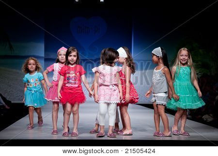 VALENCIA, SPAIN - JULY 1: Unidentified child models walk the runway at the FIMI Children's Summer Fashion Show for designer Mim-Pi in the Feria Valencia on July 1, 2011 in Valencia, Spain.