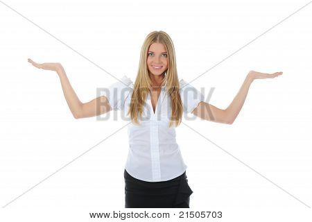 woman looks at her open palm.