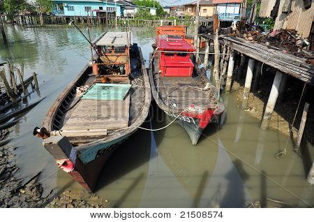 wooden fishing boat in the fishing village
