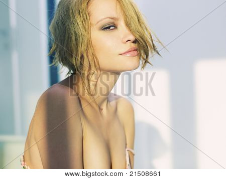 Portrait of a beautiful blonde in the sunset