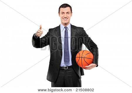 A happy businessman holding a basketball and giving thumb up isolated on white background
