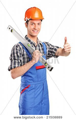 A portrait of a worker holding a construction bubble level and giving thumb up isolated on white background