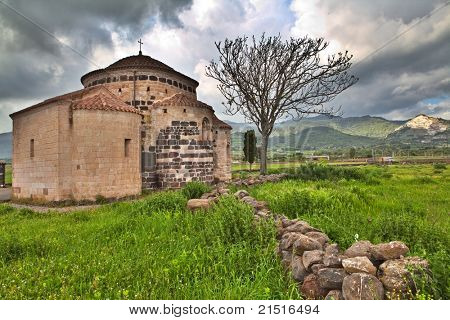 Medieval church Santa Sabina in Sardegna Italy with dark clouds historical building sardinia Italy travel and tourism history