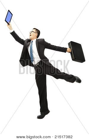 happy businessman holding tablet pc and Briefcase