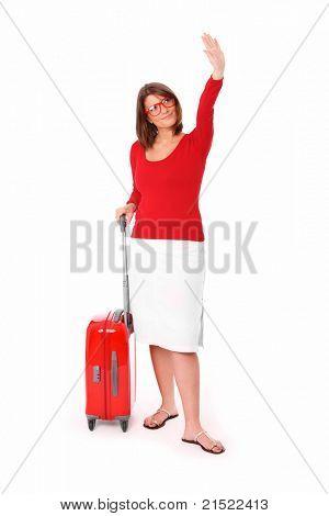 Una foto de una mujer atractiva en veintitantos agitando la mano sobre fondo blanco