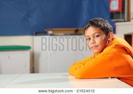 Schoolboy deep in thought