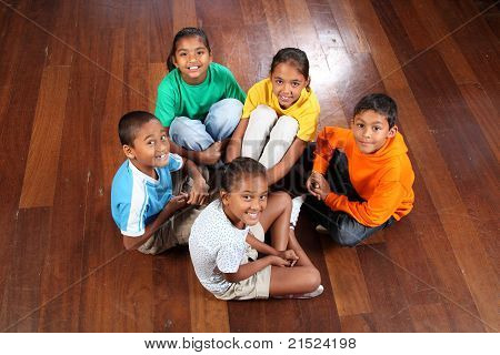 Five children in classroom floor