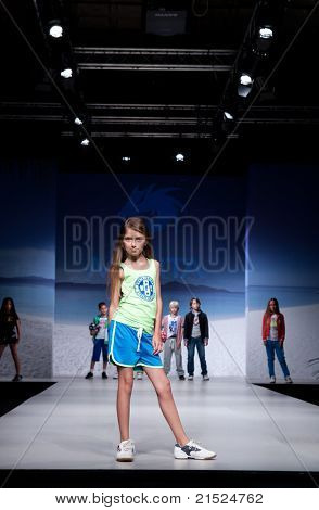 VALENCIA, SPAIN - JULY 1: An unidentified child model on the runway at the FIMI Children's Summer Fashion Show for designer Monta in the Feria Valencia on July 1, 2011 in Valencia, Spain.