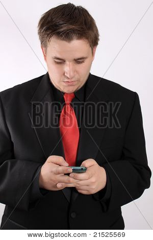 Young Businessman  Messaging On Cellphone