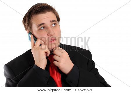 Young Businessman In Black With Cellphone