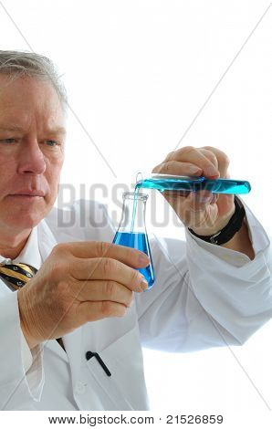 Closeup of a middle aged scientist pouring liquid from a test tube into a beaker. Vertical format isolated on white
