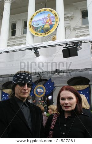 SACRAMENTO - NOV 17: Artist Gottfried Helnwein; wife at the Governor Swearing In Ceremony at the Capitol in Sacramento, California on 17 November 2003