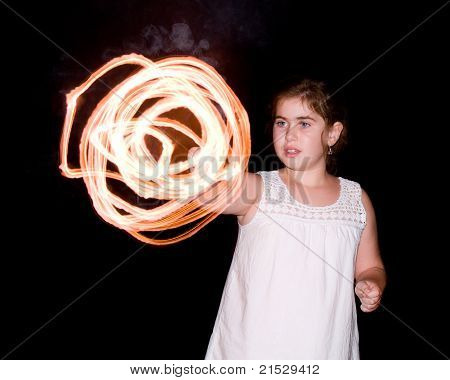 Young girl spinning sparker while celebrating Independence Day on July 4th.