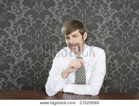 retro mustache salesperson businessman sitting in office desk on vintage wallpaper