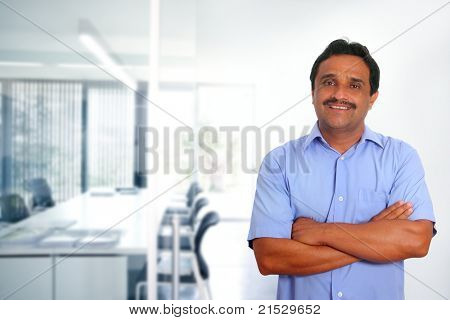Indian latin businessman with blue shirt in modern office background
