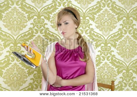 vintage woman with retro clothes iron like an humor housewife over  wallpaper