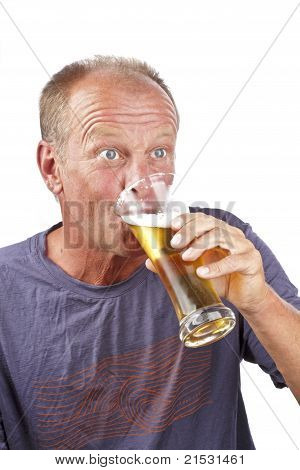 Man drinking a glass of beer on a white background