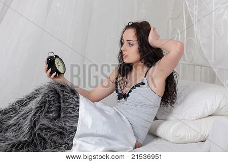 Young Woman With Alarm Clock.