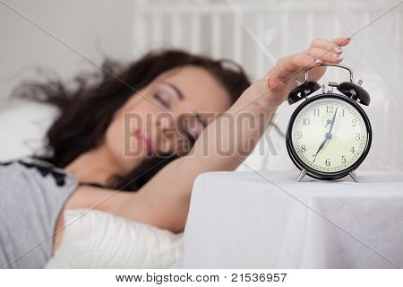 Young Woman Sleeps In Bed At Home.