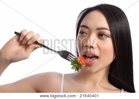 Exotic Beautiful Oriental Girl Eating Strawberry