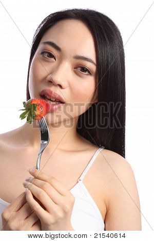 Chinese Teenager Eats Fresh Strawberry Fruit