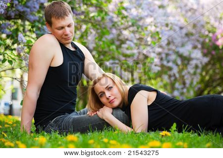 Young couple relaxing in a city park