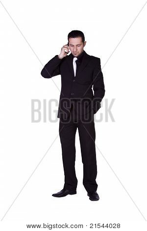 Businessman Looking Down While Talking On The Phone