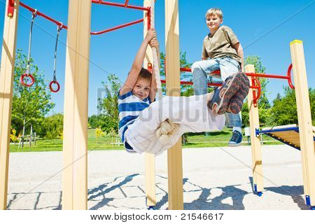 Cheerful boy swinging on rope