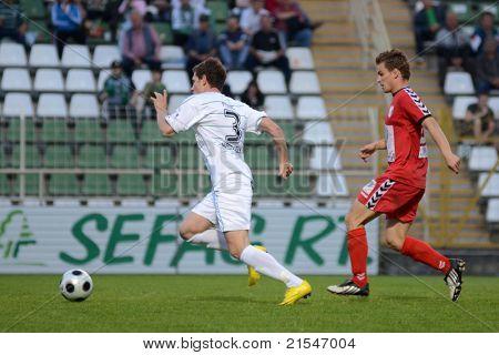 KAPOSVAR, HUNGARY - MAY 14: Milan Peric (in white) in action at a Hungarian National Championship soccer game - Kaposvar vs Szolnok on May 14, 2011 in Kaposvar, Hungary.