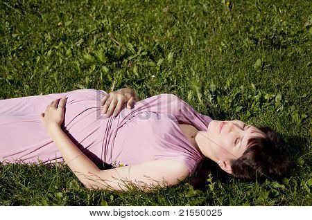 Young Pregnant woman In Park