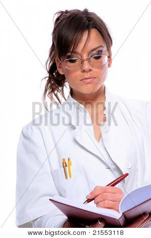 Female doctor holding a notebook - isolated over a white background