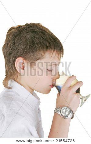 Boy Drinking A Glass Of Soda