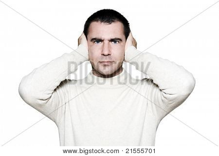 Portrait of a handsome expressive man covering his ears in studio on white isolated background