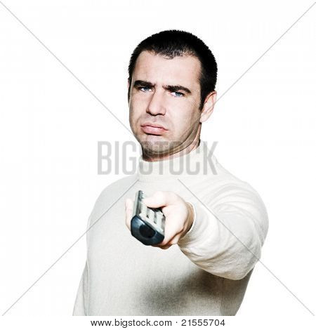 Portrait of an expressive bored man holding remote control in studio on white isolated background