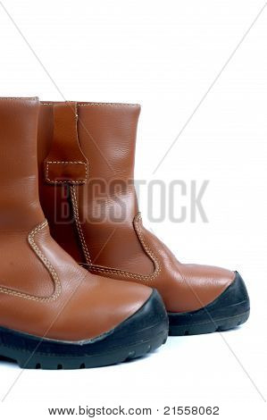 A Pair Of Brown Leather Boots