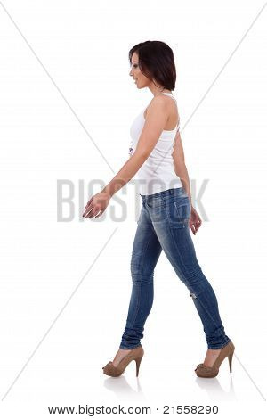 Girl Wearing Shirt And Jeans Walking