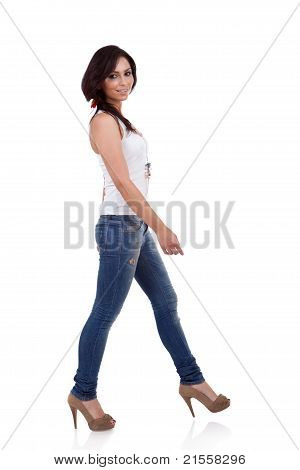 Wearing White Shirt And Jeans Walking