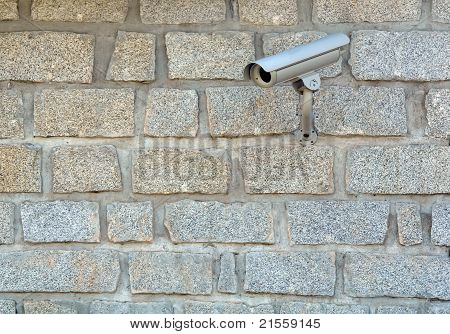 White Security Camera On The Wall