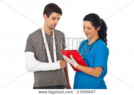 Doctor Give Prescription To Injured Man
