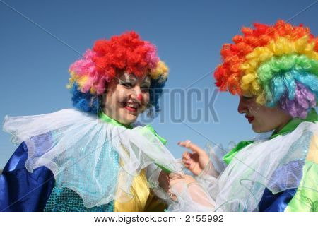 Two Bizzare Clowns In Colored Wigs 5