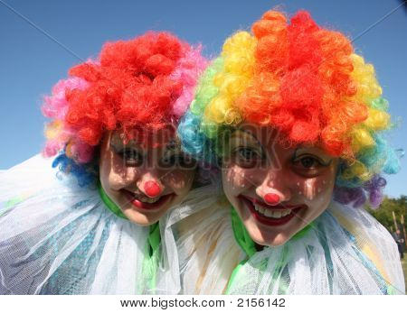 Two Bizzare Clowns In Colored Wigs 2