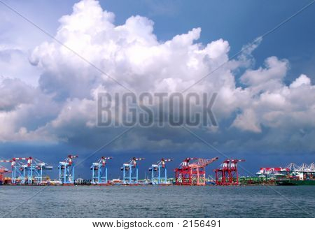 Container Cranes And Storm Clouds