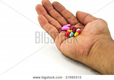 Pills In Man Hand