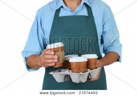 Barista holding a take out tray of disposable coffee cups. Torso only in horizontal format isolated on white.