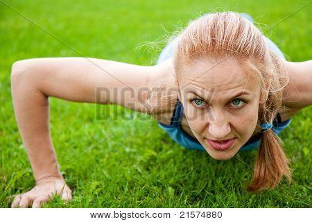Caucasian Female Doing Push Ups In The Park