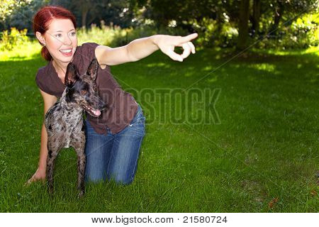 Woman Teaching Dog To Fetch