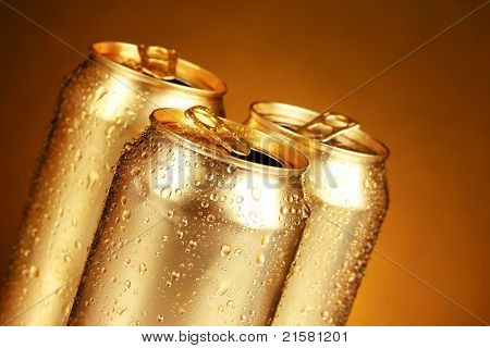 golden tin cans on yellow background