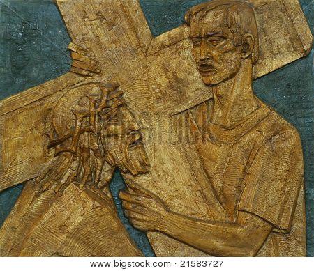 Simon of Cyrene carries the cross