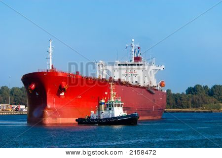 Oil Tanker And A Tugboat