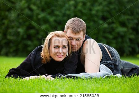Happy young couple in a city park